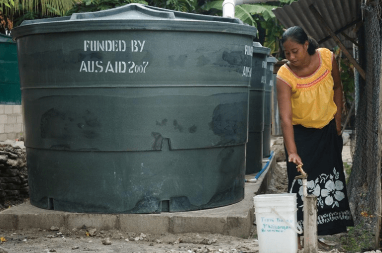 AusAid is expected to spend $30.9 million to Kiribati in Official Development Assistance in 2017-2018 and they are a major contributor to Kiribati's Official Developmental Aid. Providing holding tanks for fresh water alleviates concerns over freshwater availability and protects public health. Credit: Wikimedia Commons.
