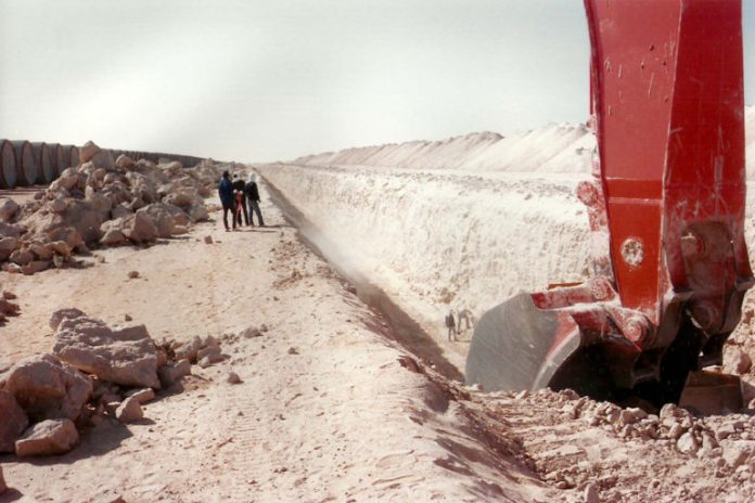 Digging a trench for Libya's Great Manmade River in the 1980s. The Great Manmade River is formed by a network of pipelines that now supplies 70% of Libya's water — an aging infrastructure network at risk of failing.