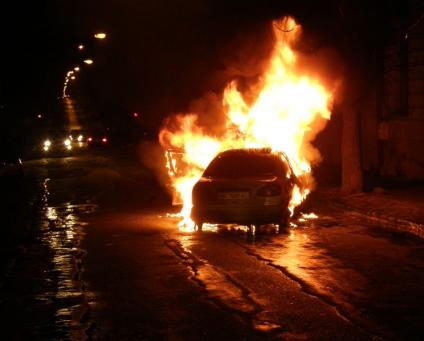 A stock photo of a burning car - not the one my brother ran to, although his description sounds the same...