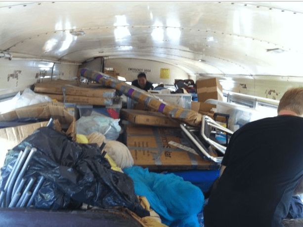 Haiti supplies being packed on the bus.