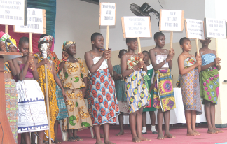Women in Ghana holding signs