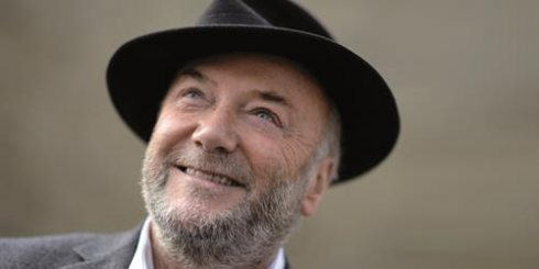 A Smiling George Galloway in a felt hat
