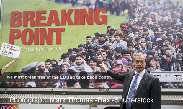 Nigel Farage standing in front of his immigration 'breaking point' poster.