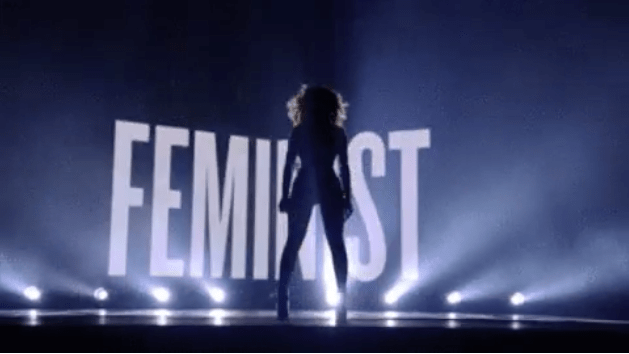 Beyoncé standing in front of the feminist sign at the MTV music awards | www.imjussayin.com