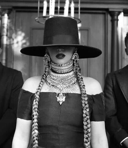 Beyonce in a large brimmed black hat | www.imjussayin.com