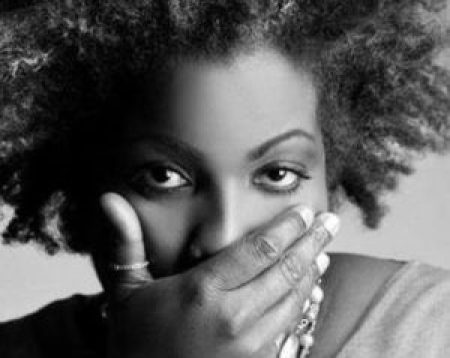 black woman with hand on mouth self censoring | www.imjussayin.com