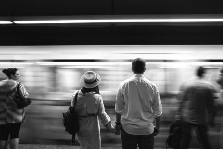 Commuter Chaos couple holding hands | www.imjussayin.com