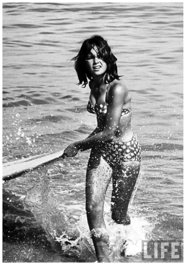 a-surf-rider-returning-after-surfing-1961-allan-grant