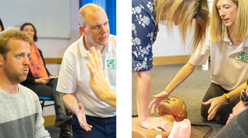 First Aid trainer with students and junior manikin