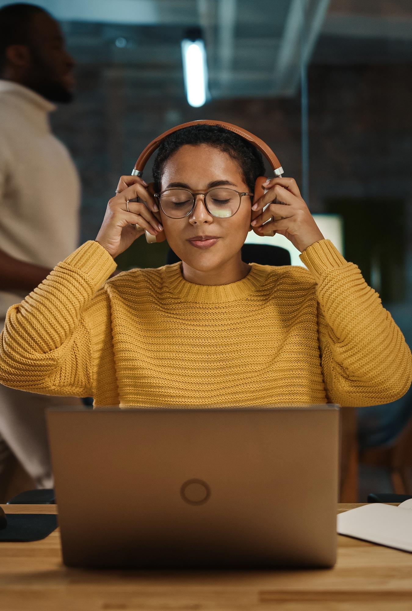Woman with headphones experiencing immersive audio