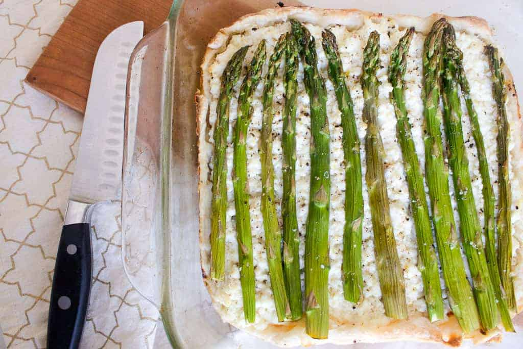 asparagus and ricotta tart ready for slicing
