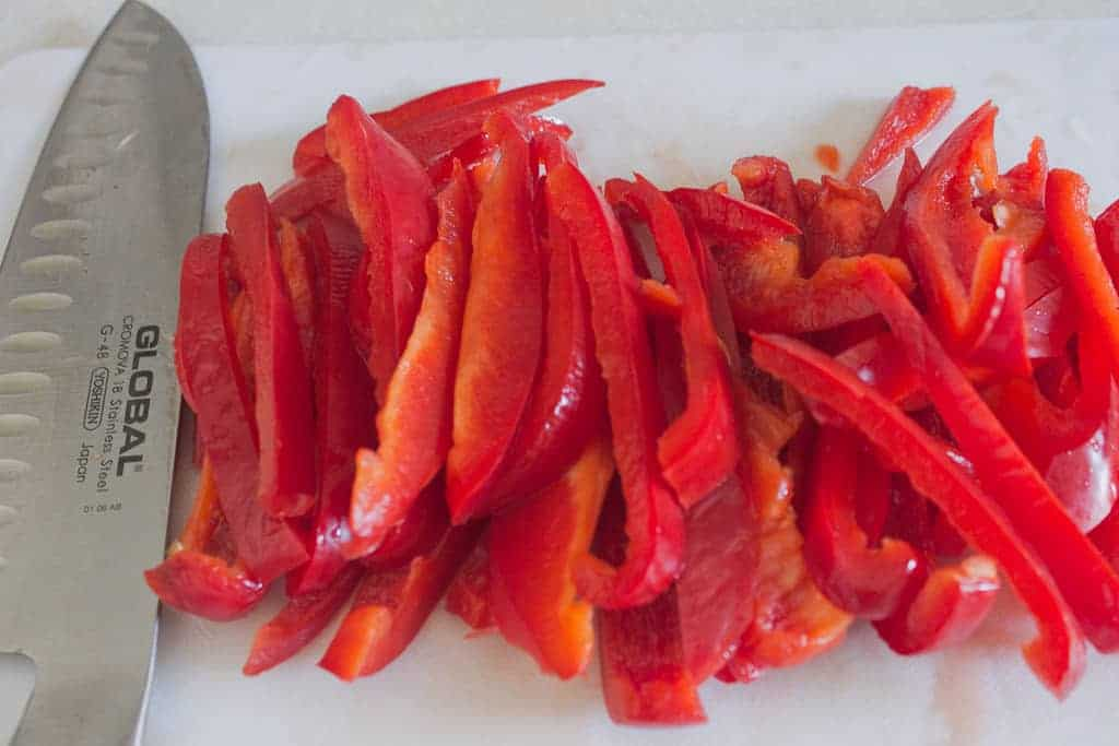 At the Immigrant's Table: Stewed cabbage with peppers and
