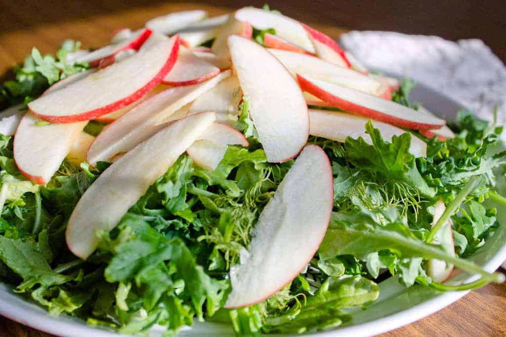 Apple and greens salad aerial shot