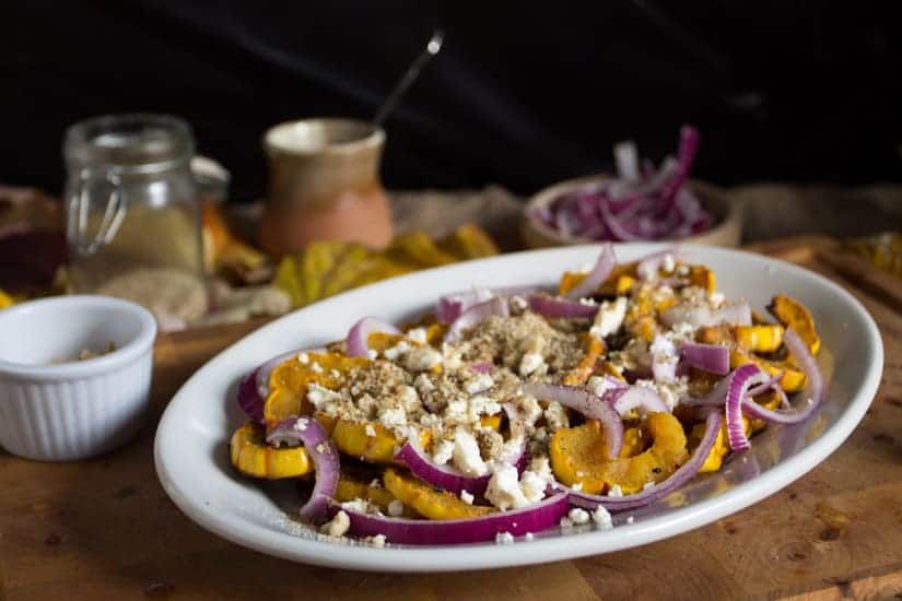 Delicata squash with feta, red onions and fragrant Middle Eastern dukkah is a perfect interplay between sweet and mellow, sharp and tangy.