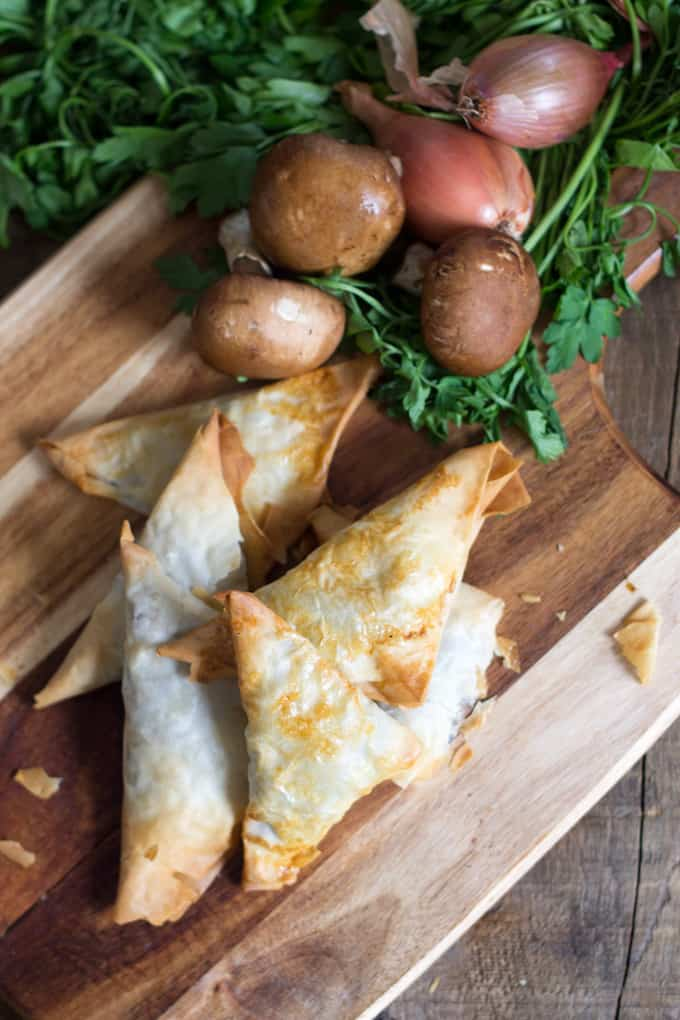 Mushroom bourekas are flaky phyllo dough pockets, filled with a salty, sweet and earthy mixture of mushrooms and caramelized onions.