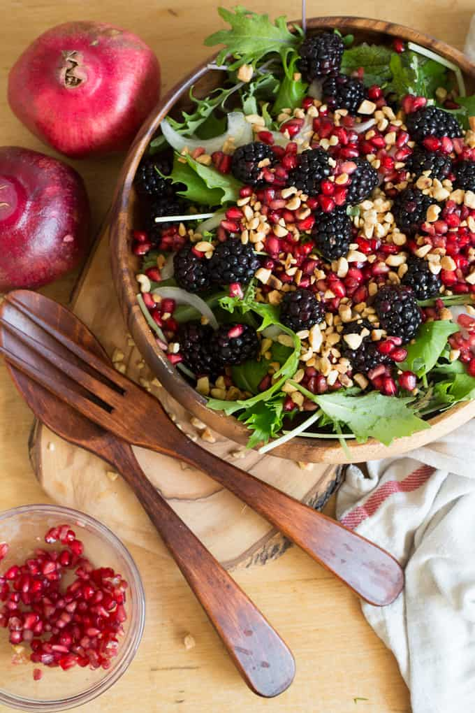 Berry Salad With Red Onions Arugula Nuts And Pomegranate Arils