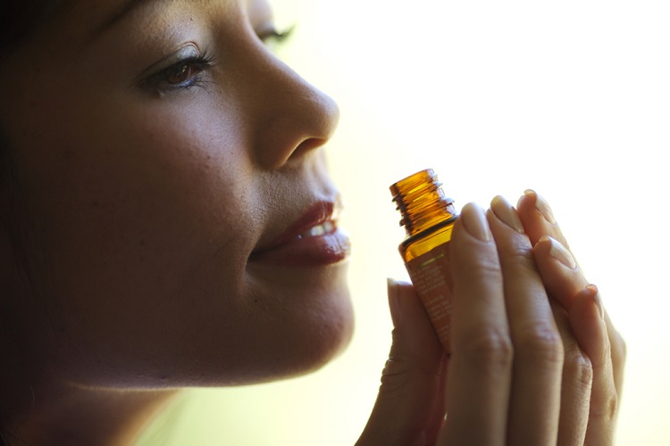 Essential oil in the hands of a girl