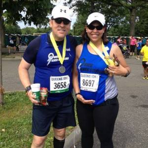 Esther and I showing our bellies after last June's Queens 10K