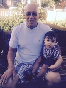Cristian and his Godfather relaxing in the yard.