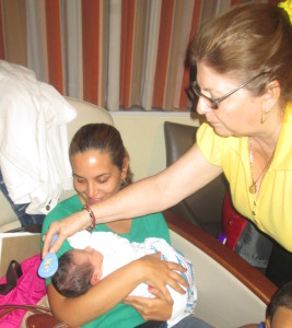 Titi Luisa, the Gold Standard for Baby Whisperers brushing Cristian's hair.