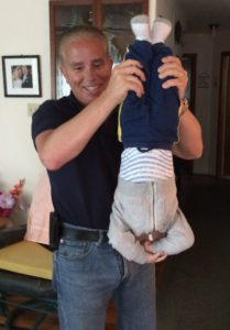 My brother showing me how to hold a baby.