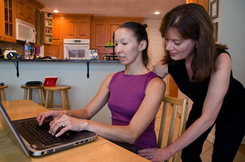 Imogen helps a student learn ways to be more comfortable working at the computer