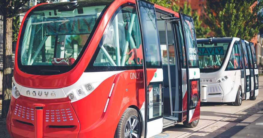 navya driverless bus red white