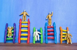 clay figures climbing clay ladders