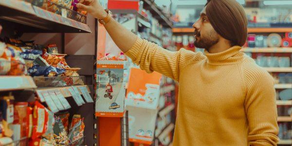 Sikh man shopping in supermarket