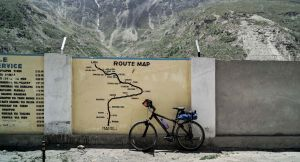 Bicycle by a route map painted on a wall