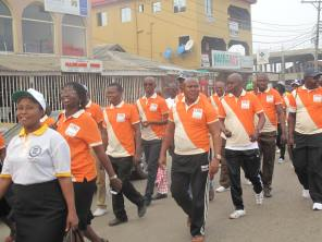 Cross section of participants walking along T.O.S. Benson Avenue, Ikorodu
