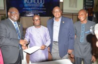 Hon. Benson with state officials after the signing of the memorandum of understanding