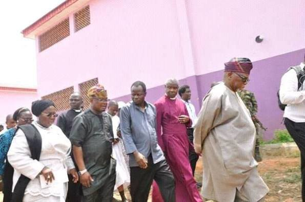 The school officials taking the government functionaries on tour of the school.