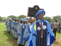 A senior lecturer leading the students of the School of Management & Business Studies in the procession to the Convocatio Ground