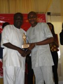 Mayor Deen Sanwoola receiving Icon award from Mr Rotimi Erogbogbo for his contribution to humanity