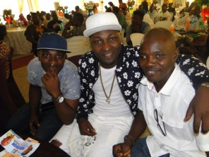 R-L, The Publisher, THE IMPACT, Kunle Adelabu, a popular artiste, Clench and his manager, Me-world at the event