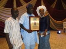 Publisher Starlight, Mr Damola Aderibigbe with Mr & Mrs Erogbogbo during the award ceremony