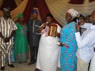 Princess Aderoju Ladega receiving '2015 Most Outstanding Youth' in Ikorodu from Comrade Okeowo