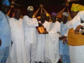 Mr Wasiu Adeshina receiving 2015 Most Outstanding Public Service award from Prince Abiodun Ogunleye