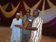 Representative of Otunba (Sir) Ayodele Elesho, Mr Kazeem Showemimo receiving the ikorodu Personality award as the 'Most Outstanding Community Statesman in Ikorodu Division' from Alhaji Badru Enifeni and the representative of the Majority Leader, Lagos State House of Assembly, Hon. Sanai Agunbiade