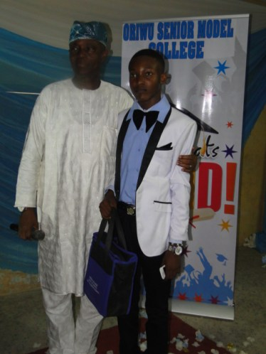 Omolade Fatai, the current Senior prefect receiving prize from Sen. Adeseye Ogunlewe as the best Mathematics student (SSS 2)