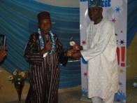 Alhaji Aremu Sule presenting an award to the former Minister of Works, Sen. Adeseye Ogunlewe