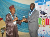 Reitired AIG Sylvester Araba receiving his award from the chairman of the occassion