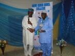 Sen. Ogunlewe presenting Alhaji Musbau Bolarinwa (R) an award