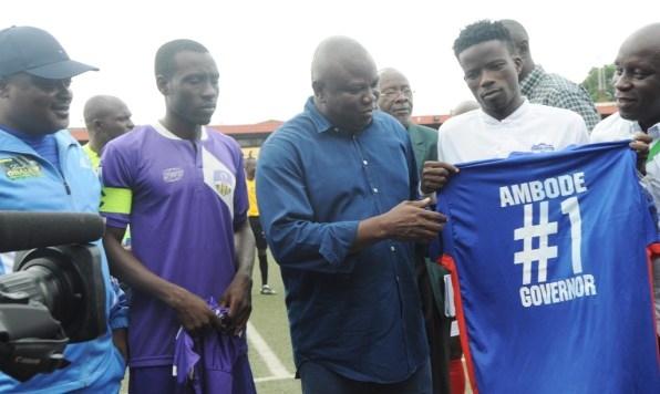 Lagos State Governor, Mr. Akinwunmi Ambode (middle), being presented with Ikorodu United Football Club jersey by the Captain, Fatai Abdullahi (2nd right); while Speaker, Lagos State House of Assembly, Rt. Hon. Mudashiru Obasa (left), Captain of MFM Football Club, Opara Austine (2nd left) and Special Adviser on Sport to the Governor, Mr. Deji Tinubu (right), watch during the Nigeria Professional Football League derby between Ikorodu United Football Club and MFM Football Club at the Agege Stadium, Lagos on Sunday, July 03, 2016.