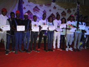 Contestants displaying their certificates of participation