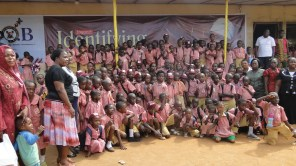 Hon. Agunbiade in group photograph with pupils of his former primary school