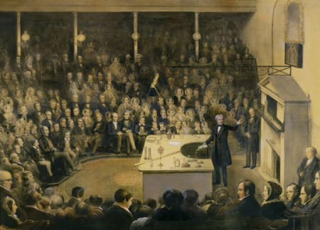 Colourised lithograph of Micheal Faraday delivering a lecture