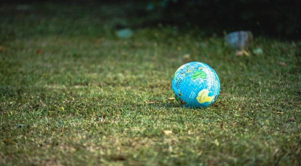 Photograph of a globe resting on grass