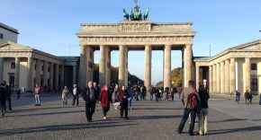 An image of tourists in front of the Brandenburg Gate in Berlin, Germany
